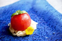 Confit Tomato stuffed with Tomato Jelly, served with Sesame Dressing