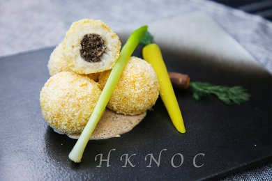 Baked risotto balls stuffed with Black Truffle Mushroom & Cheese